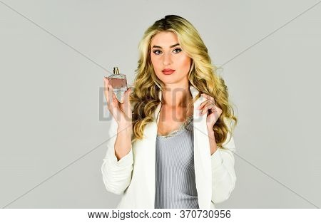 Sensual And Unusual Combination. Attractive Woman Hold Perfume Bottle. Favorite Fragrance. Female Fr