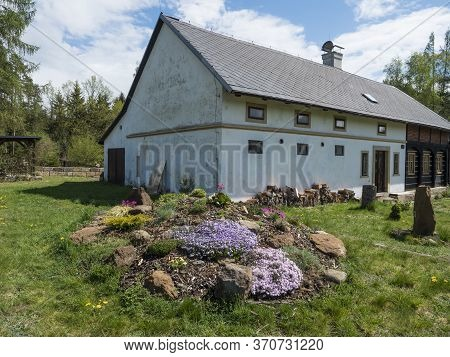 Old Half Tibered House Cootage With Garden, Rock Garden In Full Bloom With Pink Phlox, Armeria Marit