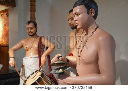 Wax Figures Of Traditional South Indian Drummers Performing During Kathakali Dance Performance. Drum