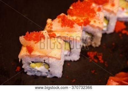 Top View Of Delicious Rice Maki With Salmon, Lemon, Tobiko, Cream Cheese, Mango.