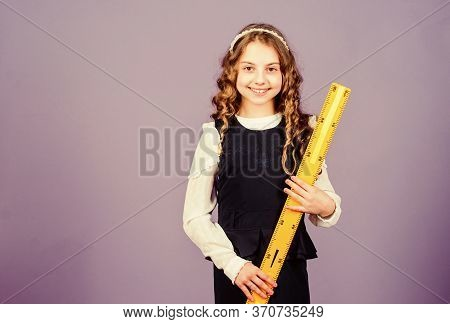 Small Girl Back To School. Pupil Girl With Big Ruler. Stem School Disciplines. School Student Learni