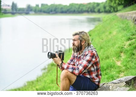 This Is The Life. Travel Tips. Professional Photographer Use Vintage Camera. Bearded Man Hipster Tak