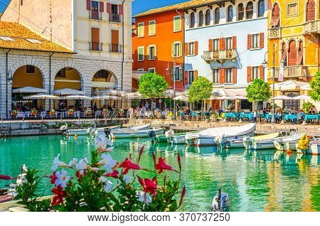 Desenzano Del Garda, Italy, September 11, 2019: Old Harbour Porto Vecchio With Boats On Turquoise Wa
