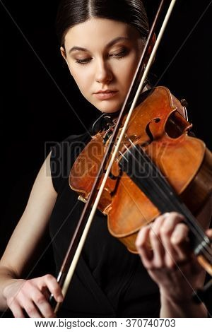Professional Musician Playing Symphony On Violin Isolated On Black