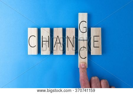 Top View Of Hand Of Person Changing The Word Change Into Chance On Wooden Blocks