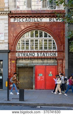 London - September 23, 2019: Students Passing In Front Of The Entrance To The Disused London Aldwych