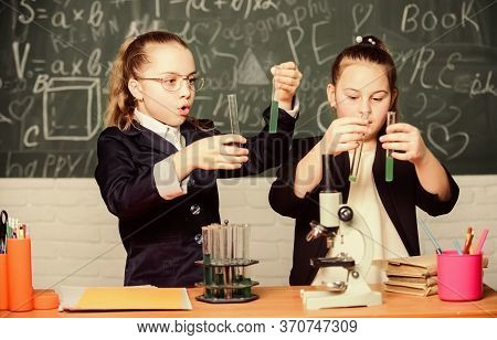 Microscope And Test Tubes On Table. Perform Chemical Reactions. Basic Knowledge Of Chemistry. Girls