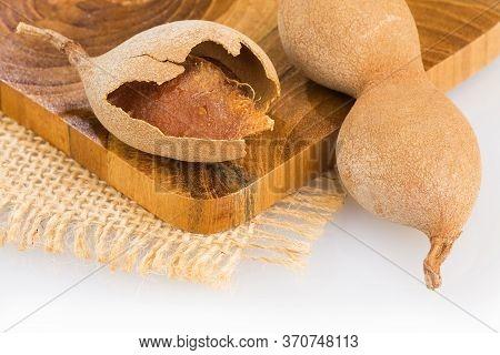 Tamarind Tropical Fruit - Tamarindus Indica. Wood Background