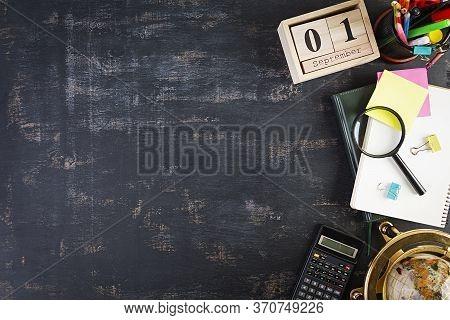 Different School Supplies On Dark Background. Concept Back To School