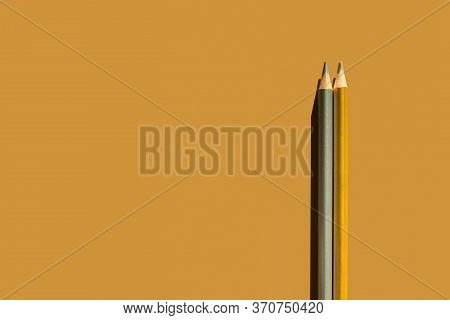 Trendy Gold And Silver Pencils On Gold Background. Back To School, Education And Learning Concept. M