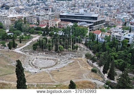 Athens, Greece - May 6, 2014: Downtown Athens City View From The Acropolis. Theatre Of Dionysus Arch