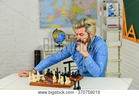 Looking For Tournament. Moving Pieces On Chess Board. Man Hold Chess Piece. Concentrated Man Develop