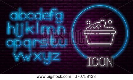 Glowing Neon Line Plastic Basin With Soap Suds Icon Isolated On Brick Wall Background. Bowl With Wat
