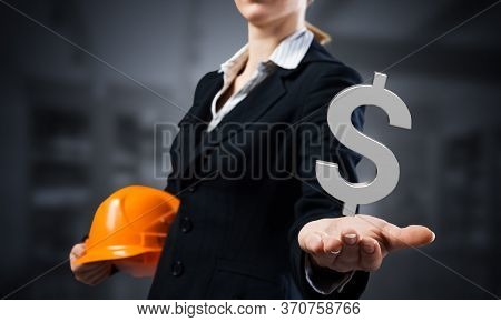Businesswoman Holds In Palm 3d Dollar Sign. Woman Trader In Business Suit With Orange Safety Helmet.
