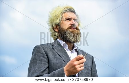 Personal Crisis Concept. Breathe In And Out. Smoking Habit Concept. Bearded Hipster Smoking Outdoors