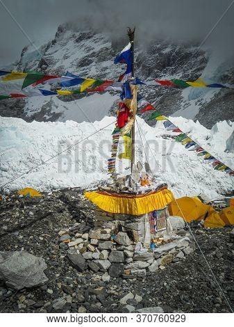 Prayer Chorten At Everest Base Camp With A Lot Of Prayer Flags