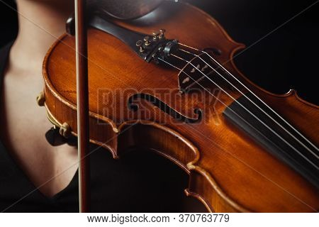 View Of Female Musician Playing Symphony On Violin Isolated On Black