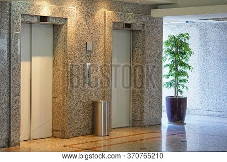 Two Elevator Doors In Office Building. Wide Angle View Of Modern Elevators With Doors. Elevators In