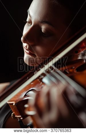 Professional Musician Playing Symphony On Violin Isolated On Black, Selective Focus