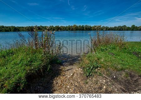 Idyllic Swimming Lake In Sommer In Southern Germany
