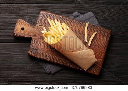 French crispy potato fries. Top view