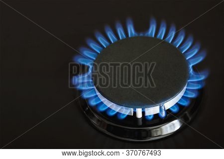 Burning Blue Gas On The Dark Stove. Burner Gas Stove, Concept Of Energy. Closeup, Selective Focus