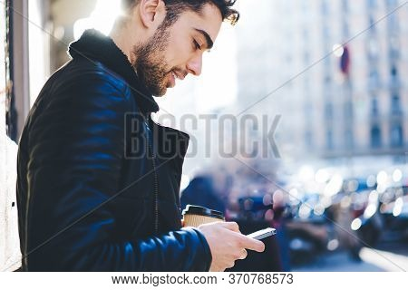 Good Looking Student Talking In Funny Atmosphere On Telephone During Strolling In City
