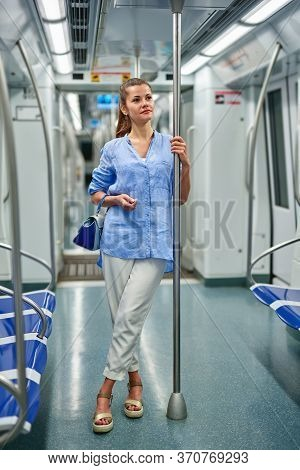 Young Woman Portrait Inside Metro Subway.woman Stands In Subway Car.