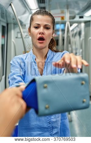 Thief Stealing Bag From Girl At Subway Car. Pickpocketing At Subway Station.