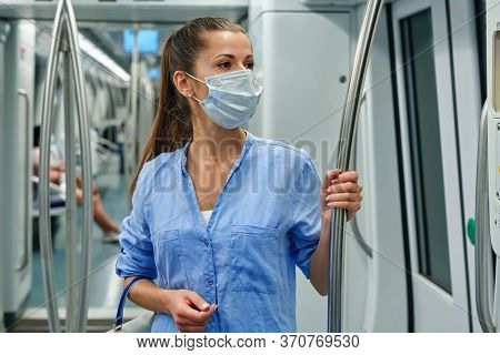 Woman Wearing A Surgical Mask In The Subway.