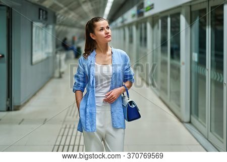 Elegant Fashion Business Woman In The Metro