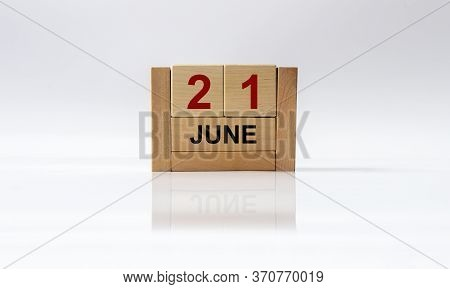 June 21st. Image Of June 21 Wooden Color Calendar On White Glossy Background With Reflection. Summer