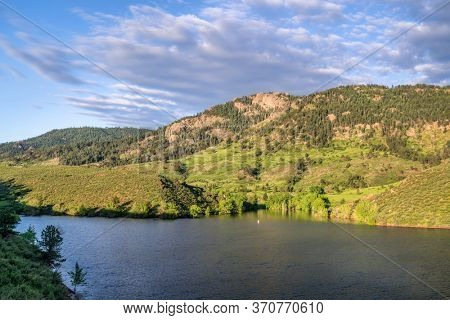 summer view of a lake at Rocky Mountains foothills -  Horsetooth Reservoir in northern Colorado with Arthur's Rock in background