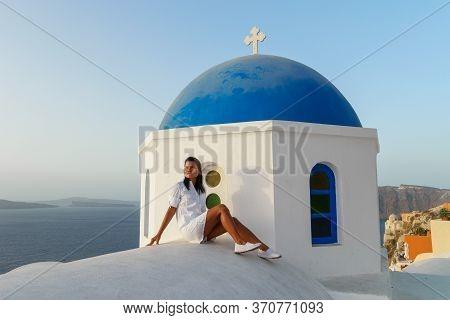Santorini Greece, Woman On Luxury Vacation Oia Santorini Island Greece Visit The White Village With