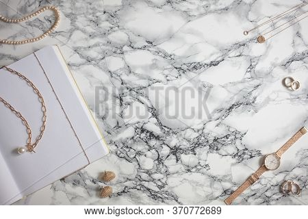 Flat Lay Jewelry On Marble Background: Chunky Chain Necklace, Pendant, Ring, Earring, Watch