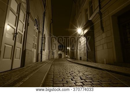 Night street of old Prague Under the light of lanterns