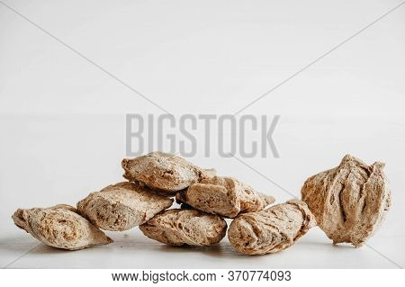 Raw Dehydrated Soy Meat Or Soya Chunks On A White Wooden Background. Copy, Empty Space For Text