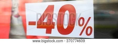 Close-up Of Sign With 40 Percent Announcement, Shopping On Reduced Prices. Label Of Shop, Announceme