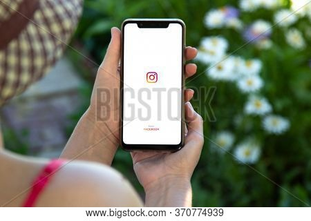 Girl hold SmartPhone displaying the Instagram logo. Social media. Instagram is a photo-sharing app. Belgorod , Russia - JUN, 10, 2020: