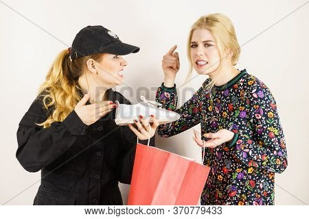Security Guard And Shoplifter.