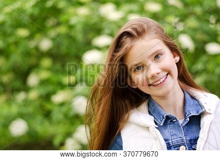 Portrait Of Adorable Smiling Little Girl Child Pre Teen In The Park Outdoors Closeup