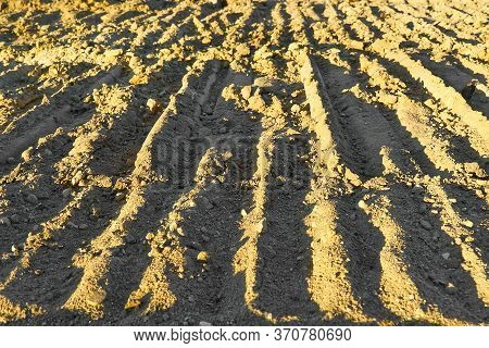 Excavator Tracks On The Ground Texture. Mud Ground Earth Soil Trace Tracks Marks Markings Dry Surfac