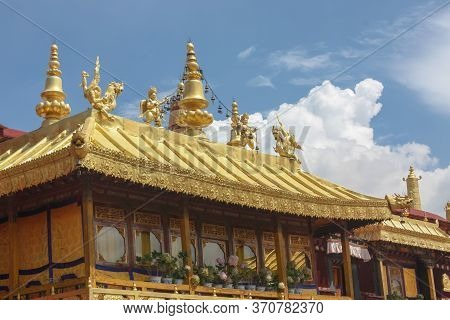 Jokhang Temple Gplden Roof In Lhasa, Tibet With Beautiful Clouds