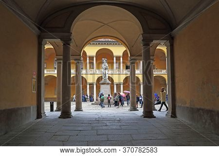 Pavia, Italy - May 15, 2018: This Is An Arched Passage Into The Cortile Voltiano Courtyard Of The Un
