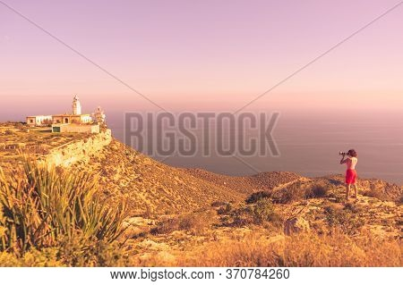 Female Tourist With Camera Taking Travel Photo From Mesa Roldan Lighthouse, Cabo De Gata Nijar Natur
