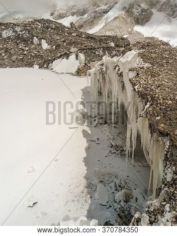 Ice Stalactite In Nepal. Beautiful Rock Cave And Pathway In The Everest Base Camp Trek