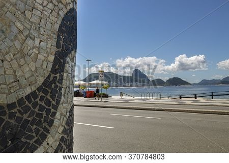 Wall With Portuguese Tile Wave Pattern Decoration With The Sugarloaf Mountain Behind A Closed Kiosk,