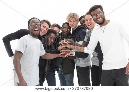 Group of friends in formal clothes putting hands together on whi