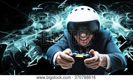 Portrait Of A Man In A Suit And Helmet Of A Pilot With A Joystick In His Hands. He Enthusiastically