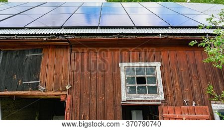 Solar Cells On A Barn Roof In Kumla Sweden